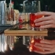 Hands of a Man and a Woman Taking Coctails From the Bar Counter - VideoHive Item for Sale