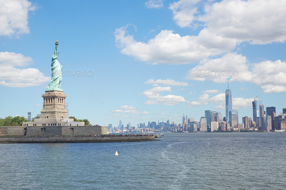 Statue of Liberty island and New York city skyline - Stock Photo - Images