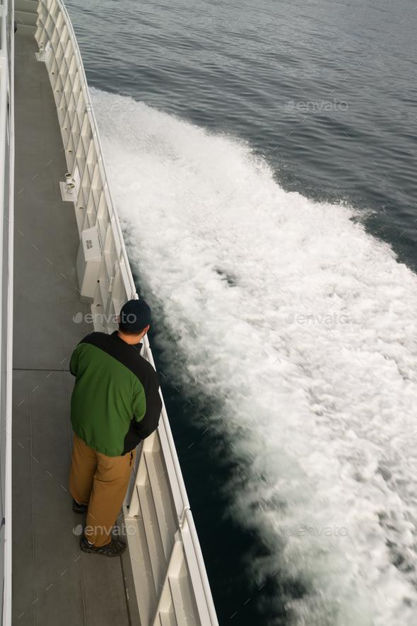 Speeding Ferry Boat Wake of Ocean Spray Man Looking - Stock Photo - Images