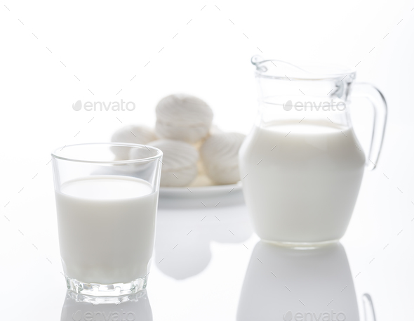 Milk and marshmallow isolated on white - Stock Photo - Images