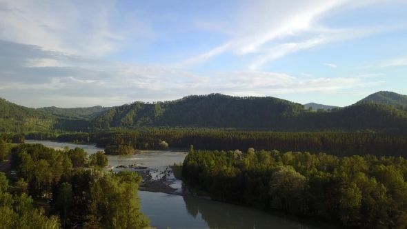 Aerial Panorama of the Green Forest and River Near Mountains
