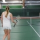 Adult Women Finished the Tennis Match, a Woman in White Sportswear Won the Competition