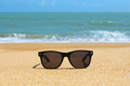 Black sunglasses on the beach - PhotoDune Item for Sale