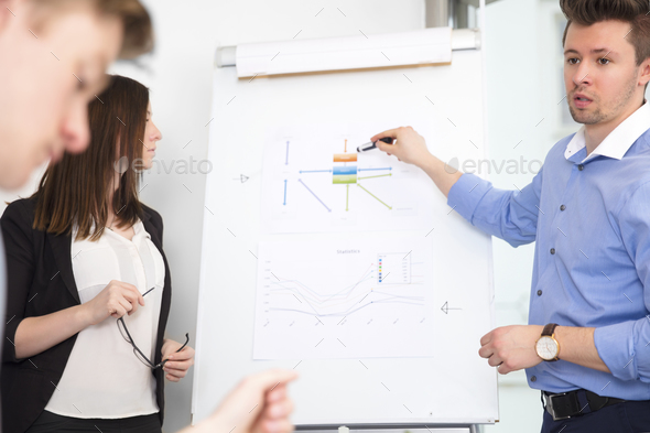 Executive Explaining Chart To Colleagues In Office - Stock Photo - Images
