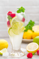 Lemon mojito cocktail with lime, mint and raspberry, cold drink with ice. - PhotoDune Item for Sale