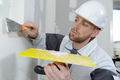 man plastering wall with trowel - PhotoDune Item for Sale