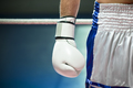 Closeup Of Boxing Gloves With Boxer Athlete On Ring - PhotoDune Item for Sale