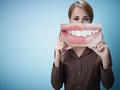 Adult Woman Holding Picture Of Big Toothy Smile In Front Of Her Face - PhotoDune Item for Sale