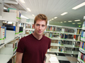 Portrait Of Young Male College Student In School Library - PhotoDune Item for Sale