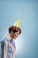 Birthday Of Businesswoman With Confetti Falling On Blue Background