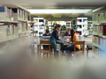 Group Of College Students Talking In Library