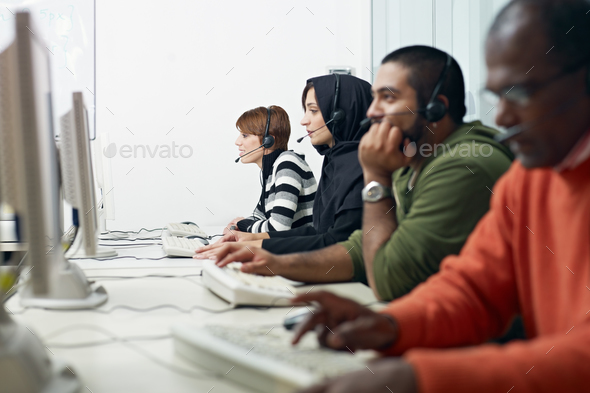 students with headset in computer lab - Stock Photo - Images