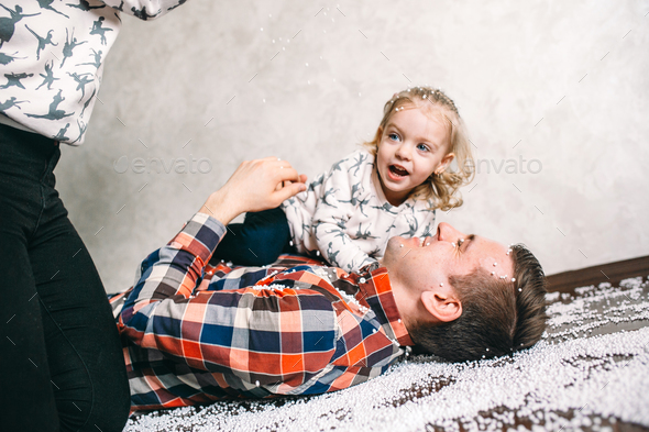 Dad plays with his daughter on the floor - Stock Photo - Images