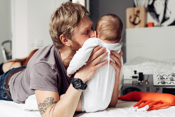 Dad and little son in the bedroom - Stock Photo - Images