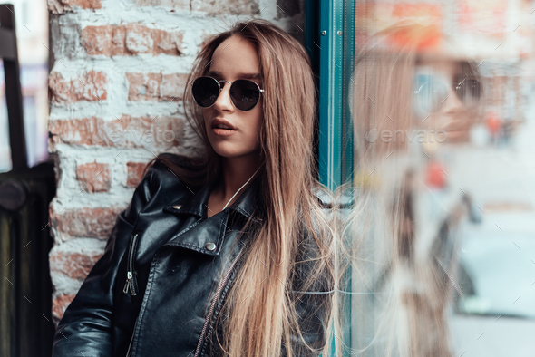 Beautiful girl in sunglasses posing on camera - Stock Photo - Images