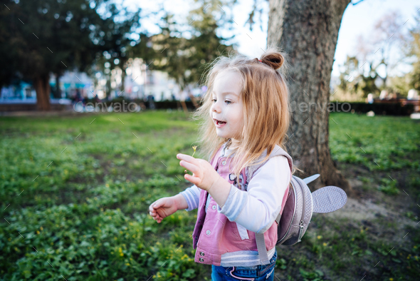Little girl walking in the park - Stock Photo - Images