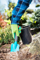 Gardener digging with a shovel. - PhotoDune Item for Sale