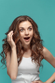 Portrait of young woman with shocked facial expression - PhotoDune Item for Sale