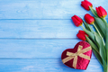 bouquet of red tulips and gift box