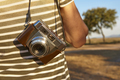 Tourist with vintage camera in the countryside. Travel background. Lifestyle