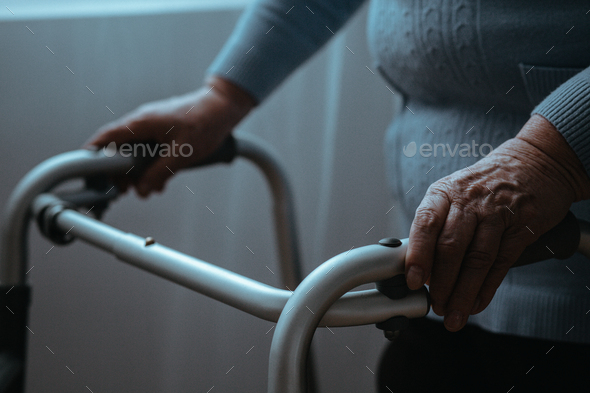 Senior with a walker - Stock Photo - Images