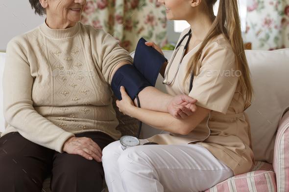 Elder during pressure measurement - Stock Photo - Images