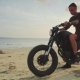 Motorcyclist Driving His Motorbike on the Beach During Sunset - VideoHive Item for Sale
