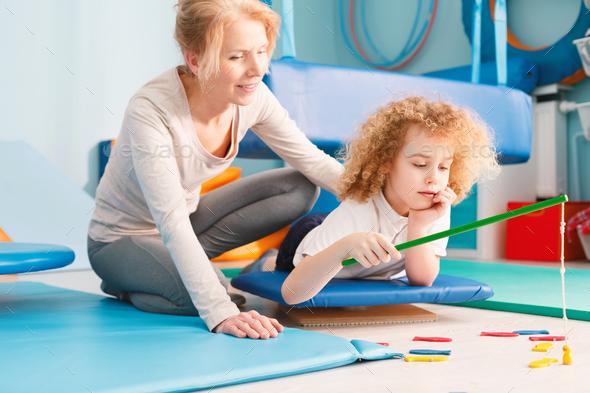 Kid having sensory integration session - Stock Photo - Images