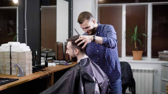 A Visitor of a Barbershop Wants To Get a Fashionable Hairdo in Barbershop