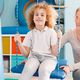 Boy sitting on a swing during therapy - PhotoDune Item for Sale