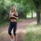 A Girl in Headphones Runs in the Park