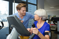physiotherapist with senior woman using exercise machine - PhotoDune Item for Sale