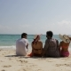 People Sitting On Beach Talking Back Rear View, Men And Women Communication Tourists Group On Summer - VideoHive Item for Sale