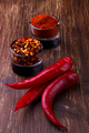Chili peppers on rustic background