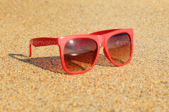 Red sunglasses on the beach - Stock Photo - Images