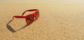 Red sunglasses on the beach - PhotoDune Item for Sale
