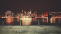 Promenade with view of Manhattan skyline at night, New York.