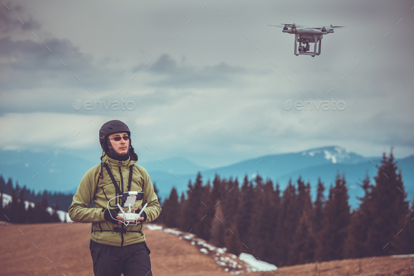 Man operating a drone - Stock Photo - Images