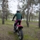 Extreme Cross Road Riding. Biker on Enduro Bike Riding Motocross in the Forest.