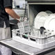 Kitchen hand with an open dishwasher - PhotoDune Item for Sale