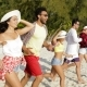 Happy People Running To Water Raising Hands On Beach, Mix Race Man And Woman Group Tourists - VideoHive Item for Sale