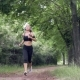 Young Woman Runs in Summer Park - VideoHive Item for Sale