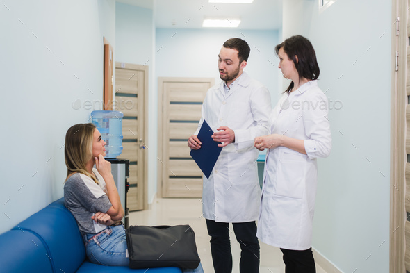 Female Patient Being Reassured By Doctors In Hospital Room - Stock Photo - Images