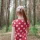 Little ginger girl walking through forest
