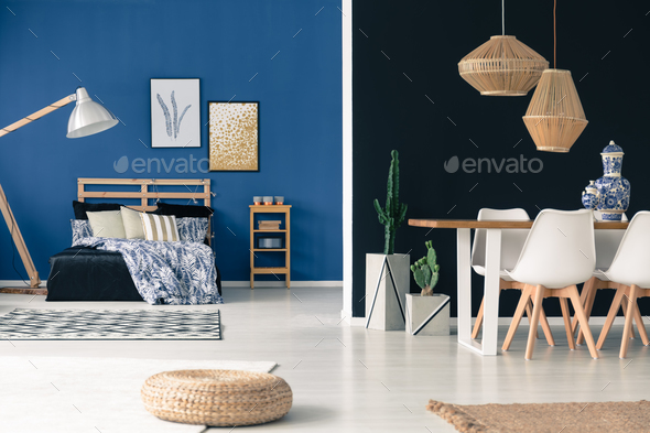 Wooden furniture in blue apartment - Stock Photo - Images