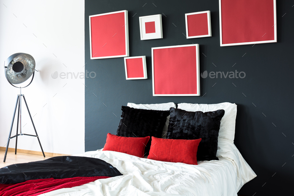 Bed on a black wall - Stock Photo - Images