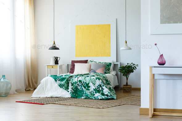 Spacious bedroom with artworks - Stock Photo - Images