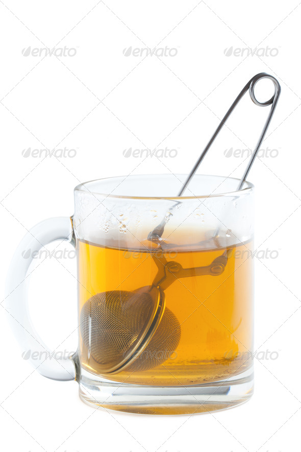 tea strainer in cup - Stock Photo - Images