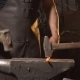 Blacksmith Forges on the Anvil. Brutal Man Working at the Forge with Metal. Blacksmith, Holds Molten