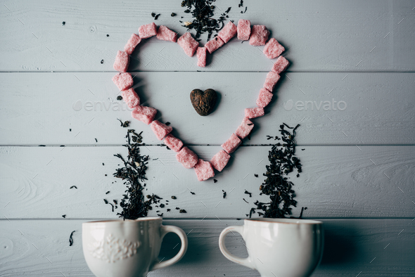 A white mug with pink heart - Stock Photo - Images